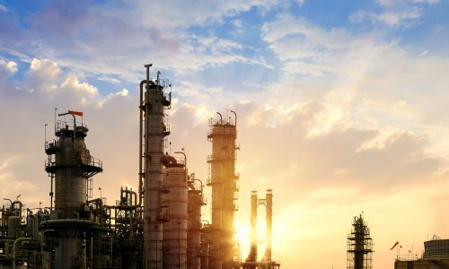 Oil and gas refinery plant or petrochemical industry on sky sunset background, Factory at evening, Manufacturing of petroleum industrial plant